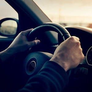 Man driving behind the wheel