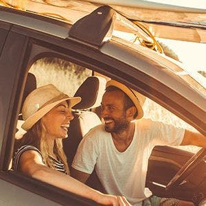 Couple laughin in a car